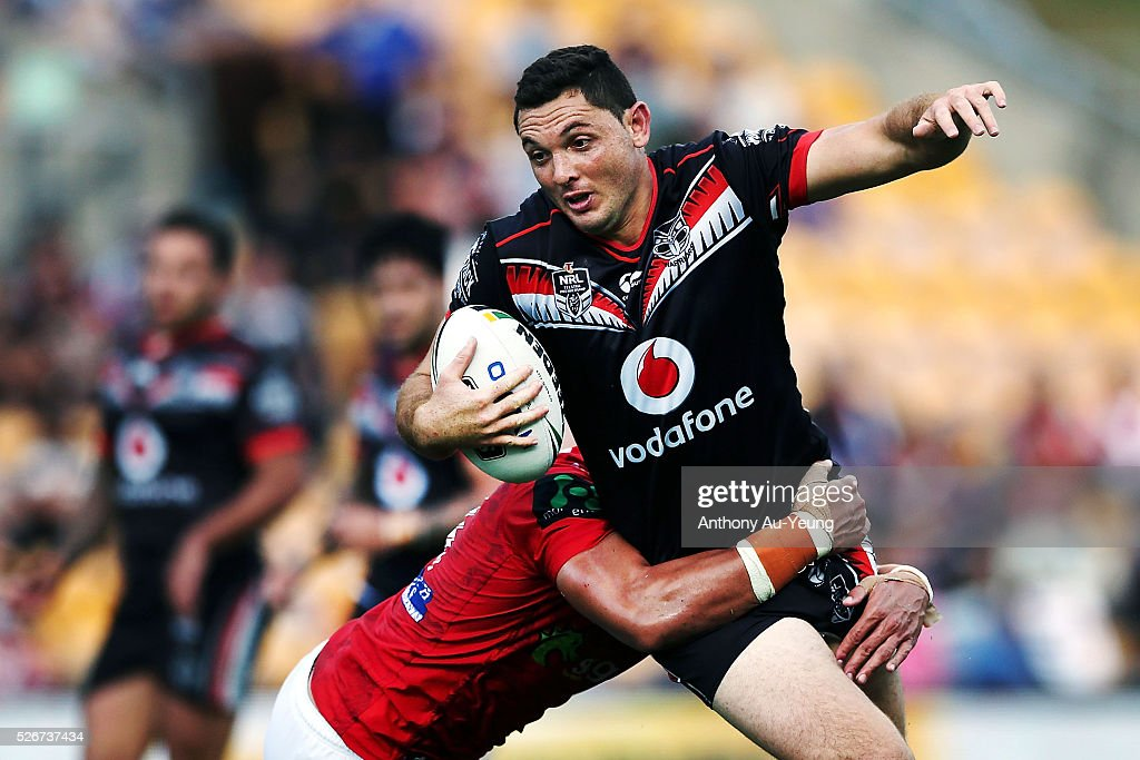 Jonathan Wright of the Warriors is tackled by Tyson Frizell of the Dragons during the round nine NRL match between the New Zealand Warriors and the St George Illawarra Dragons at Mt Smart Stadium on May 1, 2016 in Auckland, New Zealand.