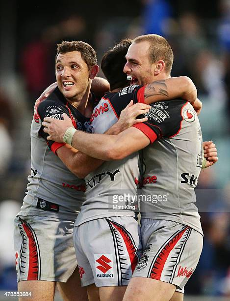 Jonathan Wright Shaun Johnson and Simon Mannering of the Warriors celebrate the winning try in golden point extra time to Bodene Thompson of the...