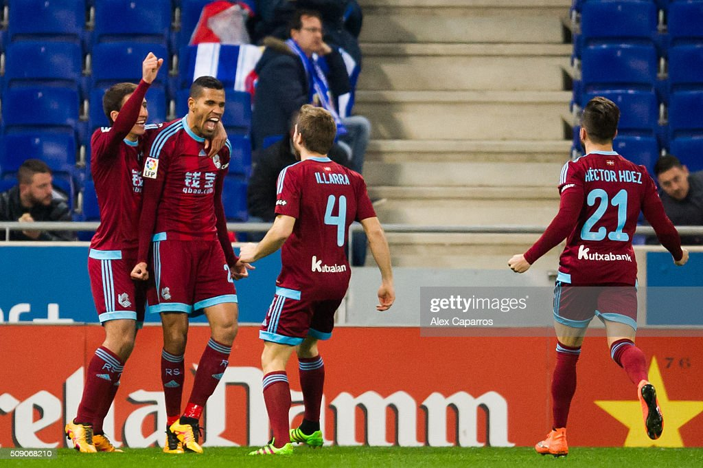 Jonathas Cristian de Jesus (2nd L) of Real Sociedad de Futbol celebrates with his teammates Mikel Oyarzabal (L), <a gi-track='captionPersonalityLinkClicked' href=/galleries/search?phrase=Asier+Illarramendi&family=editorial&specificpeople=9625979 ng-click='$event.stopPropagation()'>Asier Illarramendi</a> (3rd L) and Hector Hernandez (R) after scoring the opening goal during the La Liga match between RCD Espanyol and Real Sociedad de Futbol at Cornella-El Prat Stadium on February 8, 2016 in Barcelona, Spain.