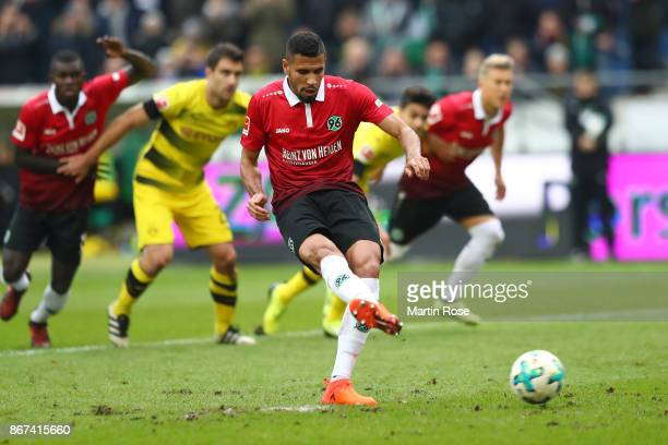 Jonathas of Hannover scores a penalty goal to make it 10 during the Bundesliga match between Hannover 96 and Borussia Dortmund at HDIArena on October...