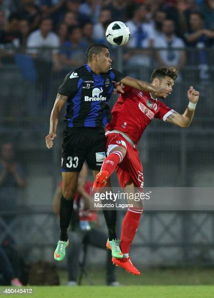 Jonathas of Latina competes for the ball in air with Stefano Sabelli of Bari during the Serie B playoff match between US Latina and AS Bari at Stadio...