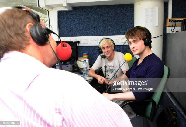 Jonathon Agnew interviews Tom Felton and Daniel Radcliffe for Test Match Special during the fifth npower Test Match at the Oval London