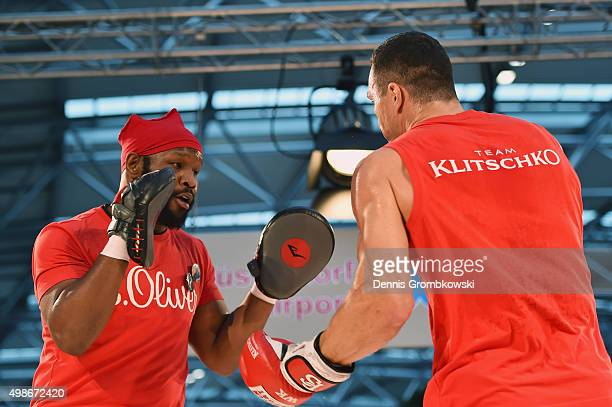 Jonathon Banks reacts as Wladimir Klitschko practices during a Media Training Session at Dusseldorf Airport on November 25 2015 in Duesseldorf Germany