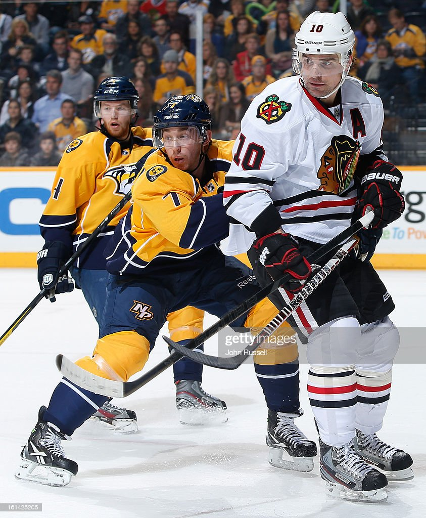 <a gi-track='captionPersonalityLinkClicked' href=/galleries/search?phrase=Jonathon+Blum&family=editorial&specificpeople=4306183 ng-click='$event.stopPropagation()'>Jonathon Blum</a> #7 of the Nashville Predators defends against <a gi-track='captionPersonalityLinkClicked' href=/galleries/search?phrase=Patrick+Sharp&family=editorial&specificpeople=206279 ng-click='$event.stopPropagation()'>Patrick Sharp</a> #10 of the Chicago Blackhawks during an NHL game at the Bridgestone Arena on February 10, 2013 in Nashville, Tennessee.