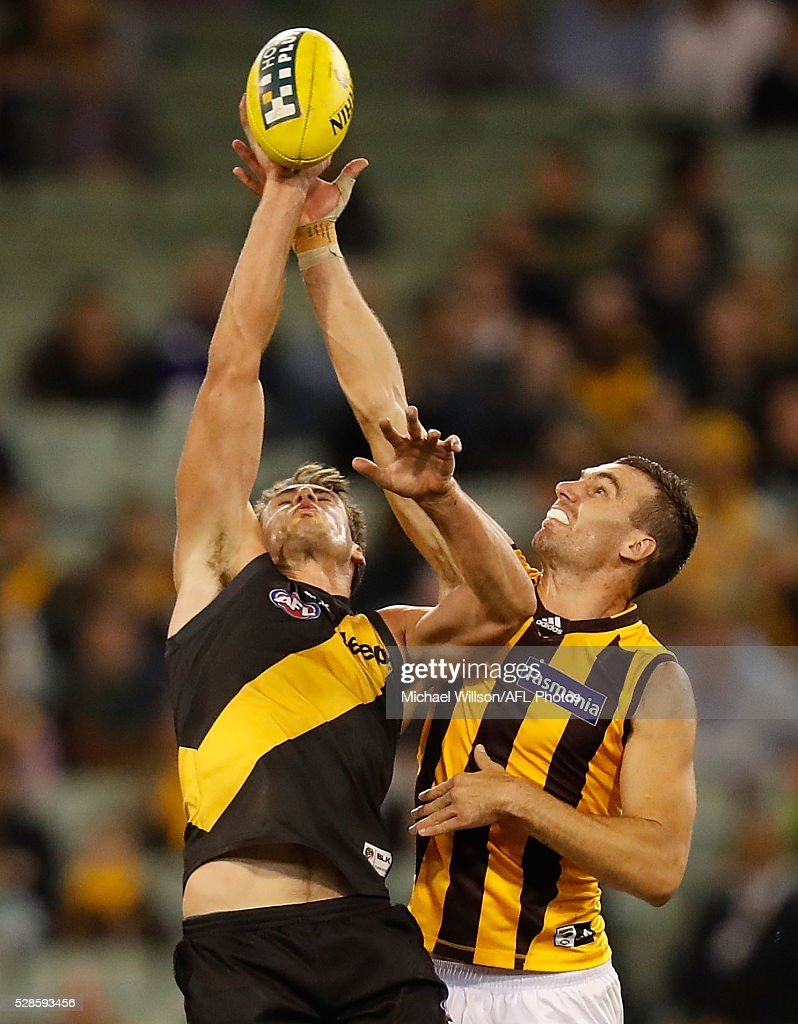 Jonathon Ceglar of the Hawks and Shaun Hampson of the Tigers compete in a ruck contest during the 2016 AFL Round 07 match between the Richmond Tigers and the Hawthorn Hawks at the Melbourne Cricket Ground, Melbourne on May 6, 2016.