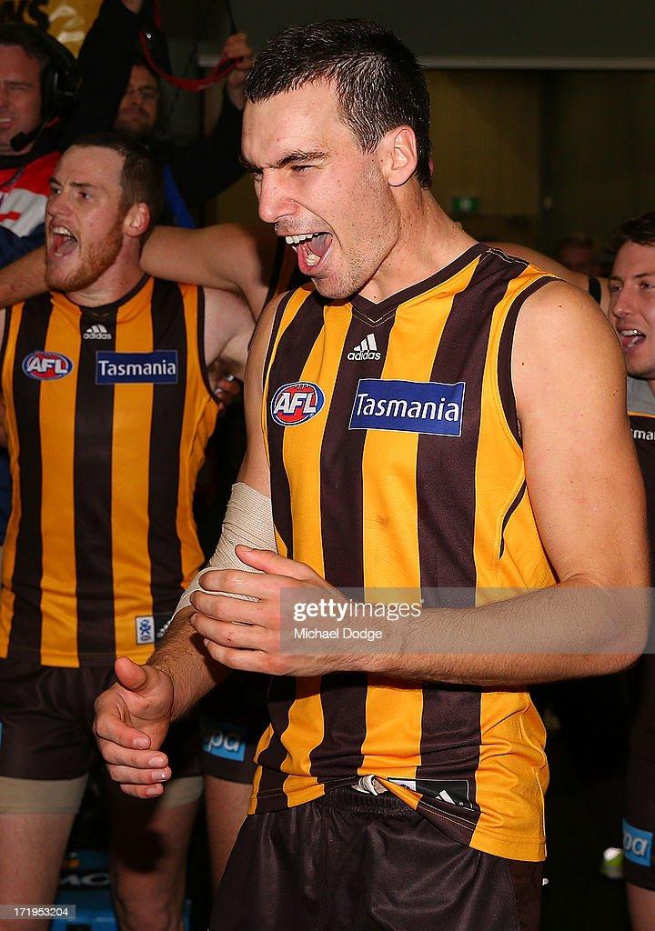 Jonathon Ceglar of the Hawks celebrates the win during the round 14 AFL match between the Hawthorn Hawks and the Brisbane Lions at Aurora Stadium on June 30, 2013 in Launceston, Australia.