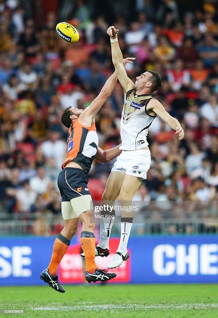 Jonathon Ceglar of the Hawks competes for the ball against Shane Mumford of the Giants during the round six AFL match between the Greater Western Sydney Giants and the Hawthorn Hawks at Spotless Stadium on April 30, 2016 in Sydney, Australia.
