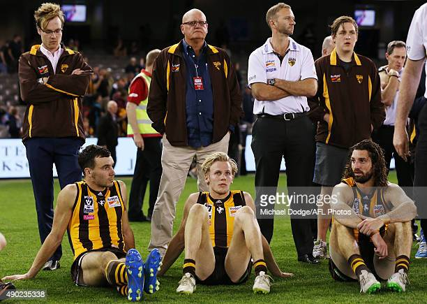 Jonathon Ceglar Will Langford and Matt Spangher of Box Hill sit after defeat during the VFL Grand Final match between Williamstown and Box Hill at...