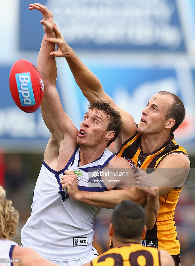 Jonathon Griffin of the Dockers challenges David Hale of the Hawks during the round four AFL match between the Hawthorn Hawks and the Fremantle Dockers at Aurora Stadium on April 20, 2013 in Launceston, Australia.