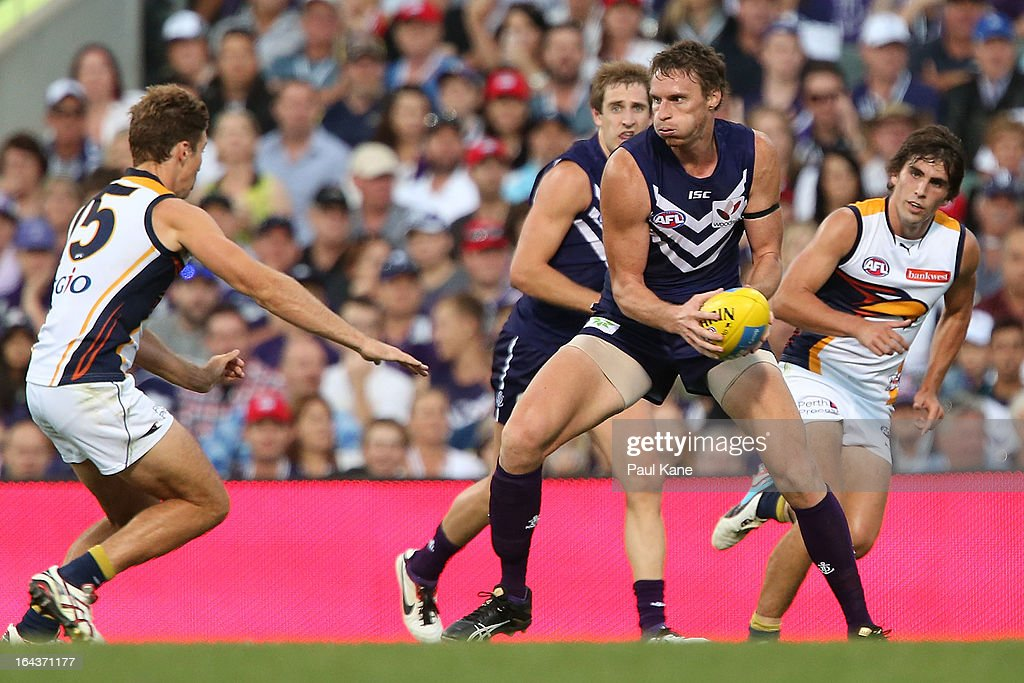 Jonathon Griffin of the Dockers looks to avoid being tackled by Jamie Cripps of the Eagles during the round one AFL match between the Fremantle Dockers and the West Coast Eagles at Patersons Stadium on March 23, 2013 in Perth, Australia.