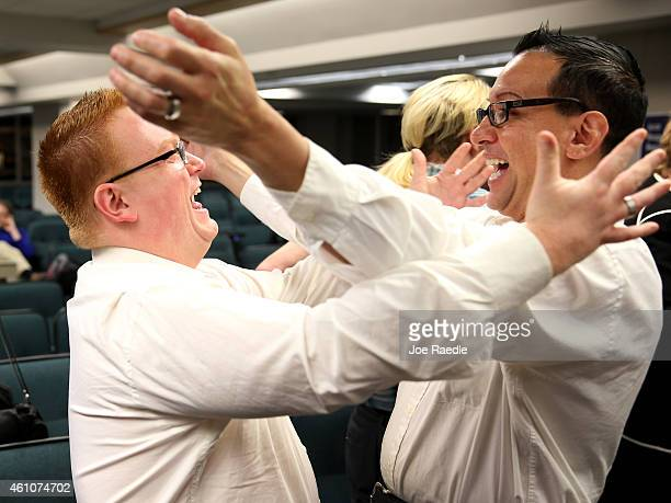 Jonathon InfanteMay and his husband Joseph InfanteMay embrace after getting married during a ceremony at the Broward County Courthouse on January 6...