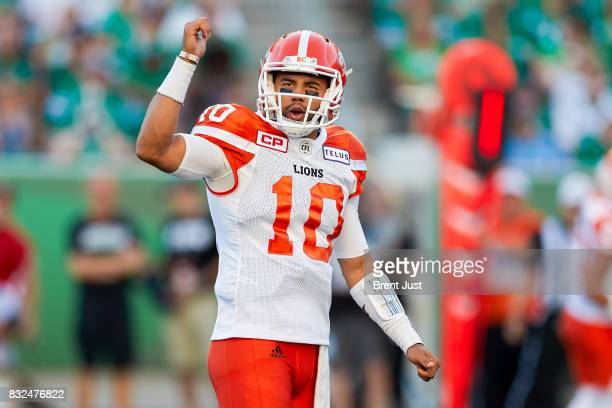 Jonathon Jennings of the BC Lions signals to his receivers before a play in the game between the BC Lions and the Saskatchewan Roughriders at Mosaic...