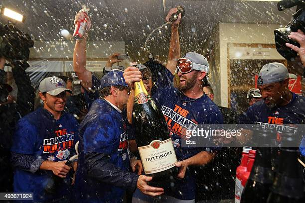 Jonathon Niese of the New York Mets celebrates in the locker room with his teammates after defeating the Chicago Cubs in game four of the 2015 MLB...
