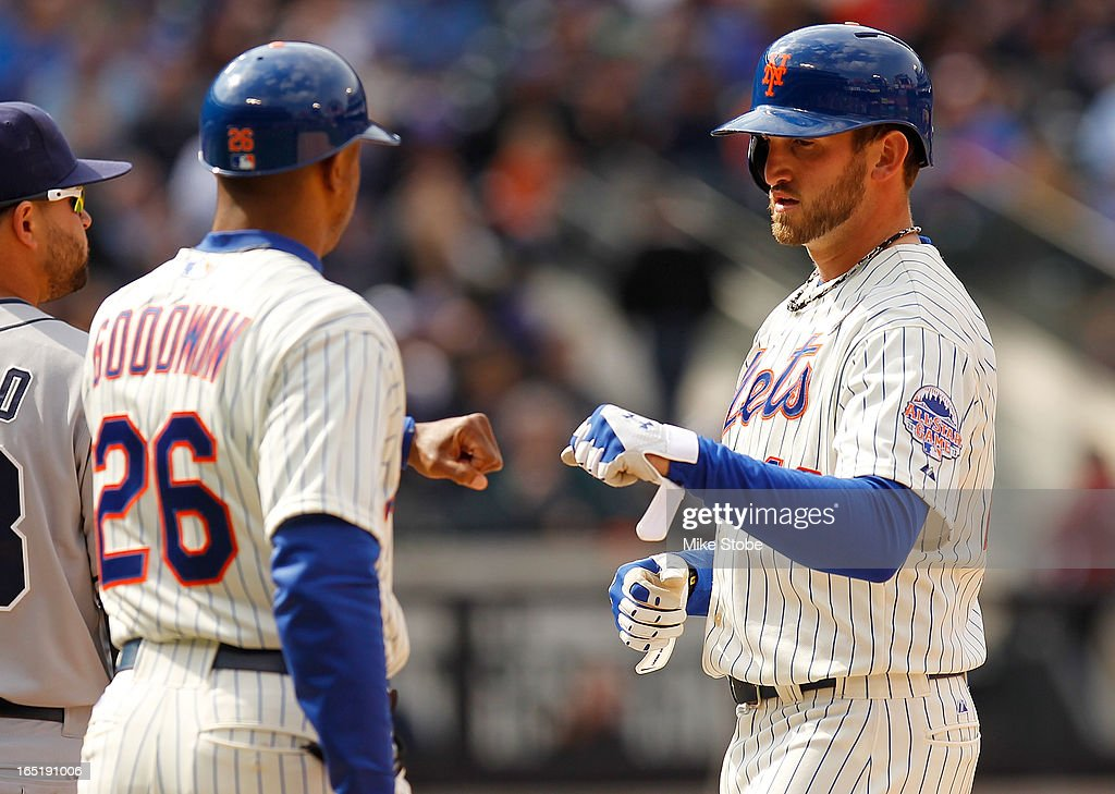 Jonathon Niese #49 of the New York Mets high-fives first-base coach first base coach <a gi-track='captionPersonalityLinkClicked' href=/galleries/search?phrase=Tom+Goodwin&family=editorial&specificpeople=184551 ng-click='$event.stopPropagation()'>Tom Goodwin</a> #26 after hitting a single at Citi Field on April 1, 2013 in the Flushing neighborhood of the Queens borough of New York City.