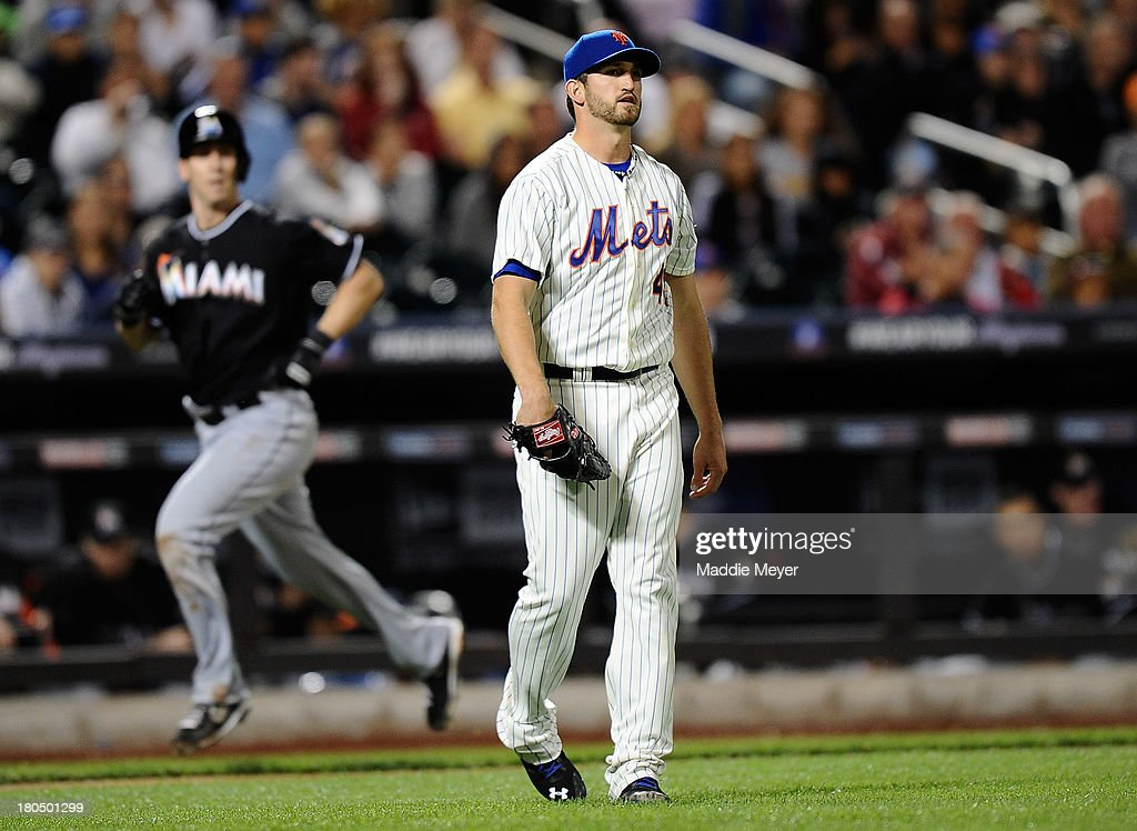 Jonathon Niese #49 of the New York Mets reacts as Ed Lucas #59 of the Miami Marlins scores at Citi Field on September 13, 2013 in New York City.