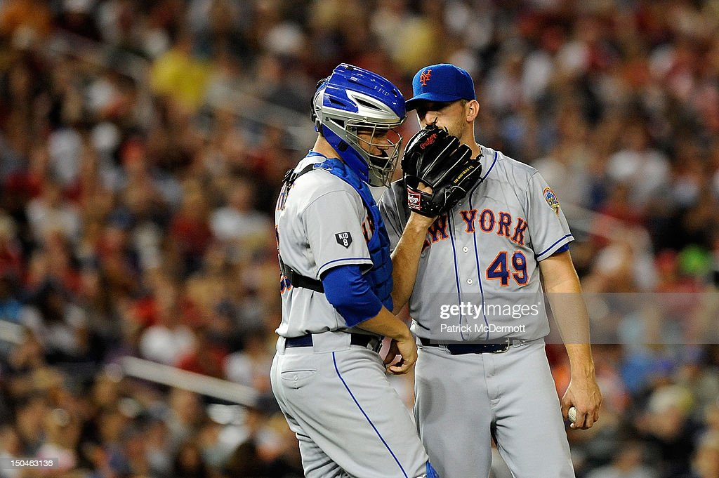 Jonathon Niese #49 talks with <a gi-track='captionPersonalityLinkClicked' href=/galleries/search?phrase=Josh+Thole&family=editorial&specificpeople=5741573 ng-click='$event.stopPropagation()'>Josh Thole</a> #30 of the New York Mets during a game against the Washington Nationals at Nationals Park on August 18, 2012 in Washington, DC.