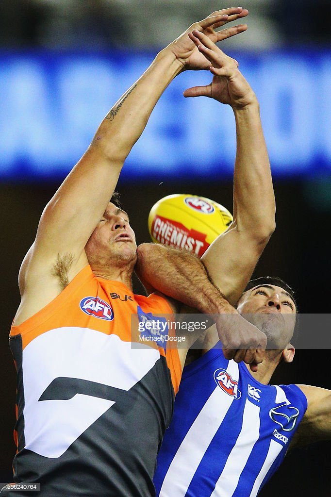 Jonathon Patton of the Giants and Michael Firrito of the Kangaroos compete for the ball during the round 23 AFL match between the North Melbourne...