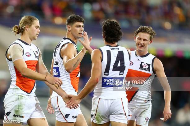 Jonathon Patton of the Giants celebrates a goal with team mates during the round 14 AFL match between the Brisbane Lions and the Greater Western...