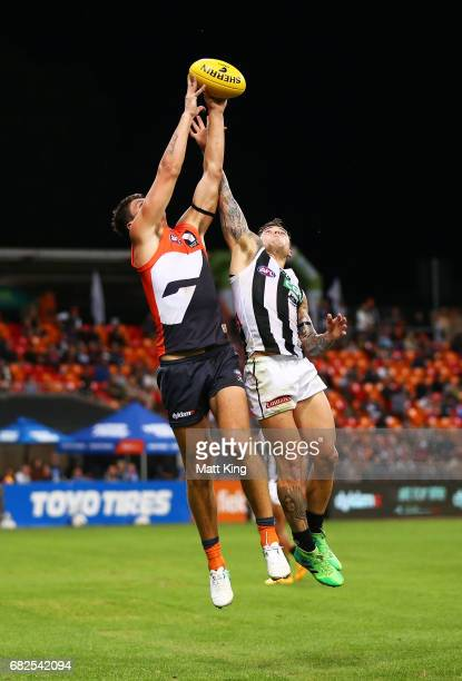 Jonathon Patton of the Giants is challenged by Jamie Elliott of the Magpies during the round eight AFL match between the Greater Western Sydney...