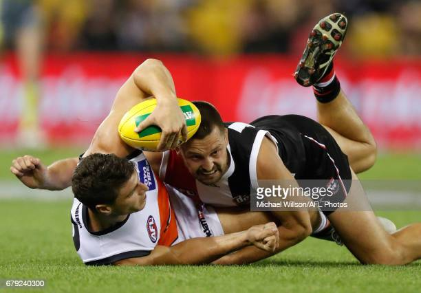 Jonathon Patton of the Giants is tackled by Jarryn Geary of the Saints during the 2017 AFL round 07 match between the St Kilda Saints and the GWS...
