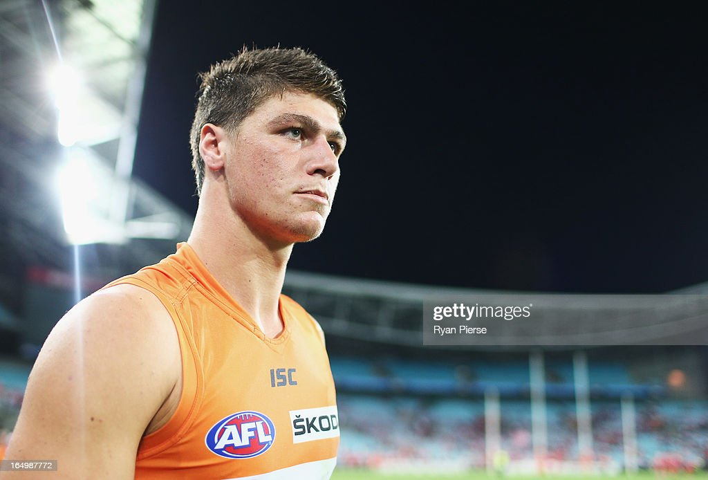 Jonathon Patton of the Giants leaves the ground after the round one AFL match between the Greater Western Sydney Giants and the Sydney Swans at ANZ Stadium on March 30, 2013 in Sydney, Australia.