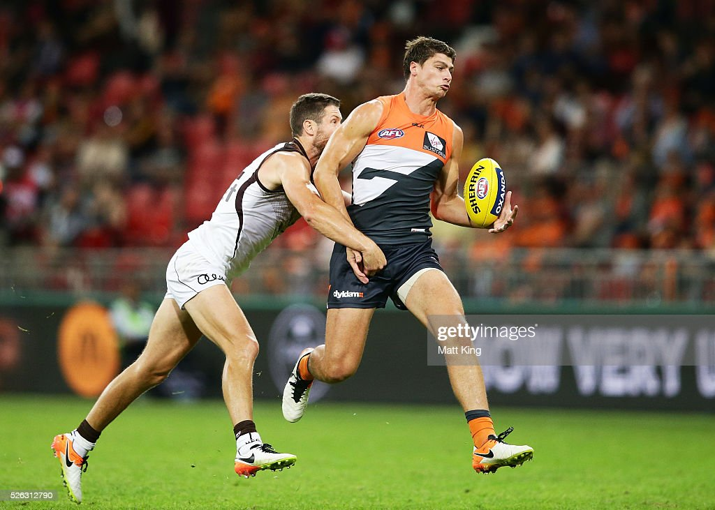 Jonathon Patton of the Giants takes a mark under pressure from James Frawley of the Hawks during the round six AFL match between the Greater Western Sydney Giants and the Hawthorn Hawks at Spotless Stadium on April 30, 2016 in Sydney, Australia.