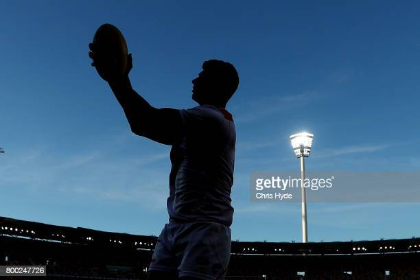 Jonathon Patton of the Giants warms up before the round 14 AFL match between the Brisbane Lions and the Greater Western Sydney Giants at The Gabba on...