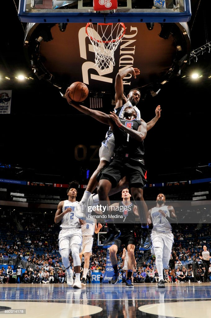 Jonathon Simmons #17 of the Orlando Magic on the defense as Jawun Evans #1 of the LA Clippers shoots the ball on December 13, 2017 at Amway Center in Orlando, Florida.