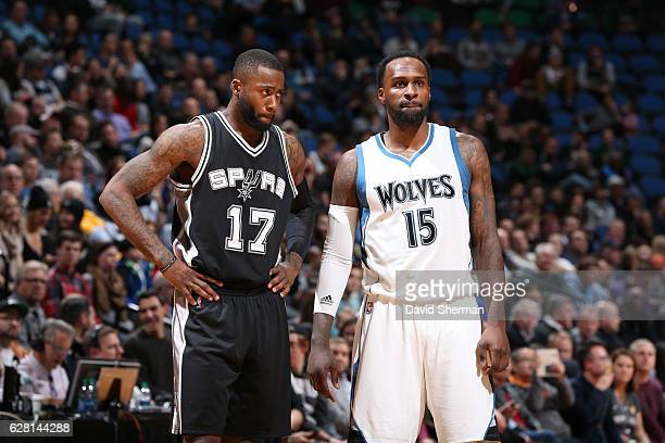 Jonathon Simmons of the San Antonio Spurs and Shabazz Muhammad of the Minnesota Timberwolves look on during a game on December 6 2016 at the Target...