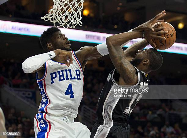 Jonathon Simmons of the San Antonio Spurs attempts a shot as Nerlens Noel of the Philadelphia 76ers defends on December 7 2015 at the Wells Fargo...