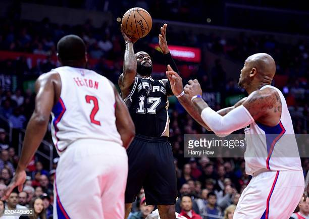Jonathon Simmons of the San Antonio Spurs attempts a shot between Raymond Felton and Marreese Speights of the LA Clippers during a 106101 loss to the...