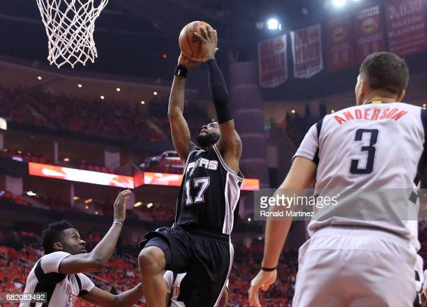 Jonathon Simmons of the San Antonio Spurs dunks against Clint Capela of the Houston Rockets during Game Six of the NBA Western Conference SemiFinals...