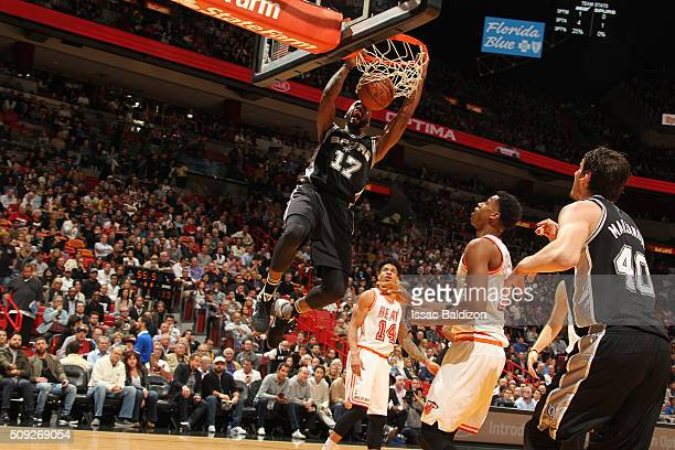 Jonathon Simmons of the San Antonio Spurs dunks against the Miami Heat on February 9 2016 at American Airlines Arena in Miami Florida NOTE TO USER...