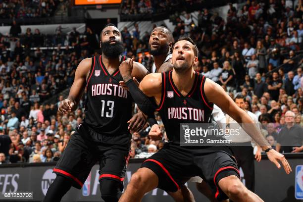 Jonathon Simmons of the San Antonio Spurs fights for the position against James Harden and Ryan Anderson of the Houston Rockets during Game Five of...
