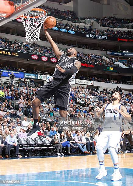 Jonathon Simmons of the San Antonio Spurs goes up for a lay up against the Dallas Mavericks on November 30 2016 at the American Airlines Center in...