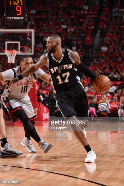 Jonathon Simmons of the San Antonio Spurs handles the ball against the Houston Rockets during Game Six of the Western Conference Semifinals of the...