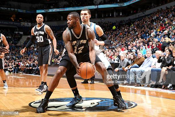 Jonathon Simmons of the San Antonio Spurs handles the ball during the game against the Minnesota Timberwolves on March 8 2016 at Target Center in...