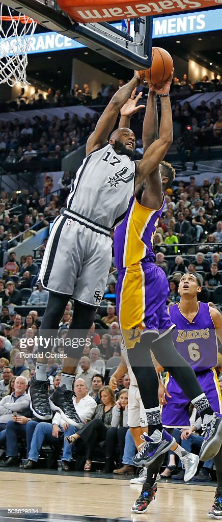 Jonathon Simmons #17 of the San Antonio Spurs scores over <a gi-track='captionPersonalityLinkClicked' href=/galleries/search?phrase=Julius+Randle&family=editorial&specificpeople=10784969 ng-click='$event.stopPropagation()'>Julius Randle</a> #30 of the Los Angeles Lakers at AT&T Center on February 6, 2016 in San Antonio, Texas.