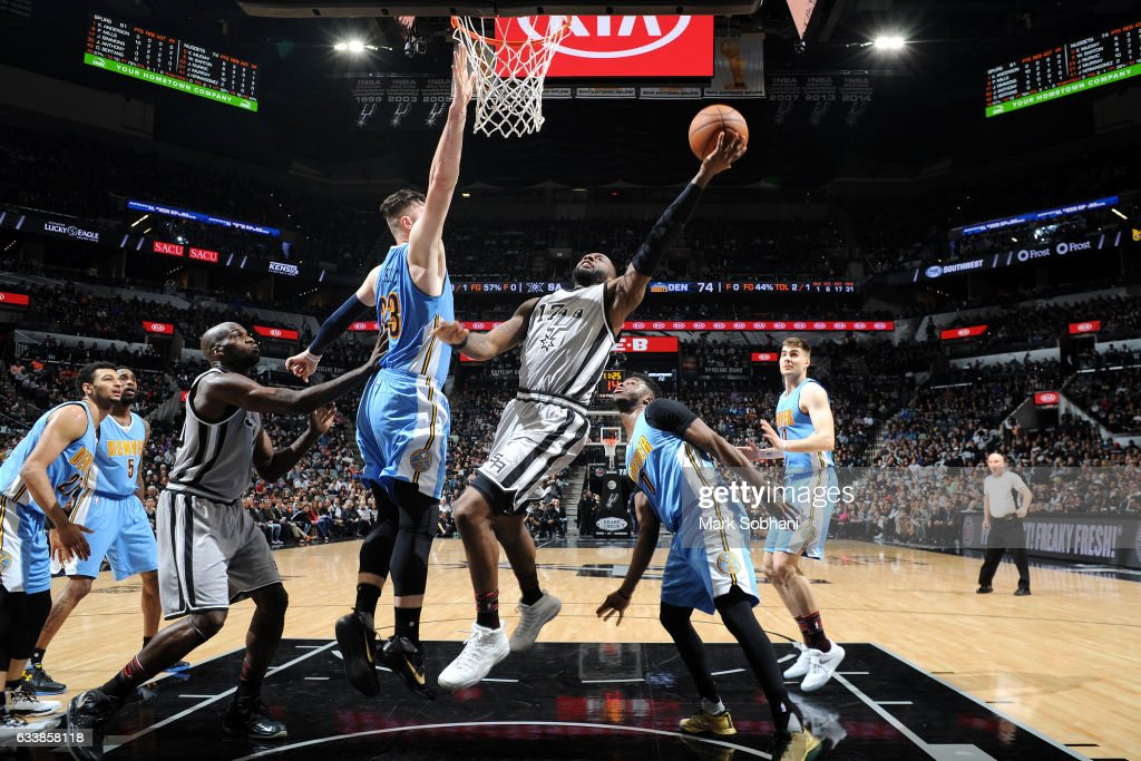 Jonathon Simmons #17 of the San Antonio Spurs shoots a lay up during the game against the Denver Nuggets on February 4, 2017 at the AT&T Center in San Antonio, Texas.