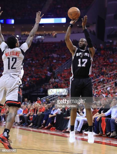 Jonathon Simmons of the San Antonio Spurs shoots against Lou Williams of the Houston Rockets during Game Six of the NBA Western Conference SemiFinals...