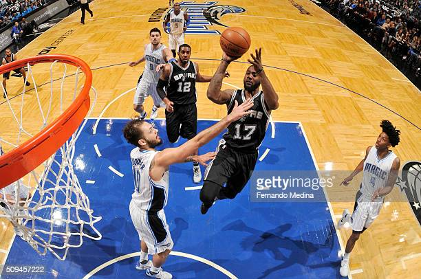 Jonathon Simmons of the San Antonio Spurs shoots the ball against the Orlando Magic on February 10 2016 at Amway Center in Orlando Florida NOTE TO...