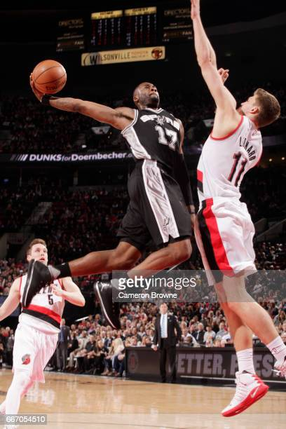 Jonathon Simmons of the San Antonio Spurs shoots the ball against the Portland Trail Blazers during the game on April 10 2017 at the Moda Center in...