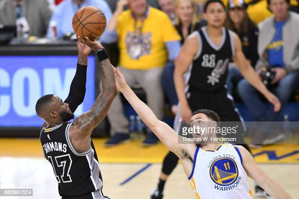 Jonathon Simmons of the San Antonio Spurs takes a shot against Klay Thompson of the Golden State Warriors during Game Two of the NBA Western...