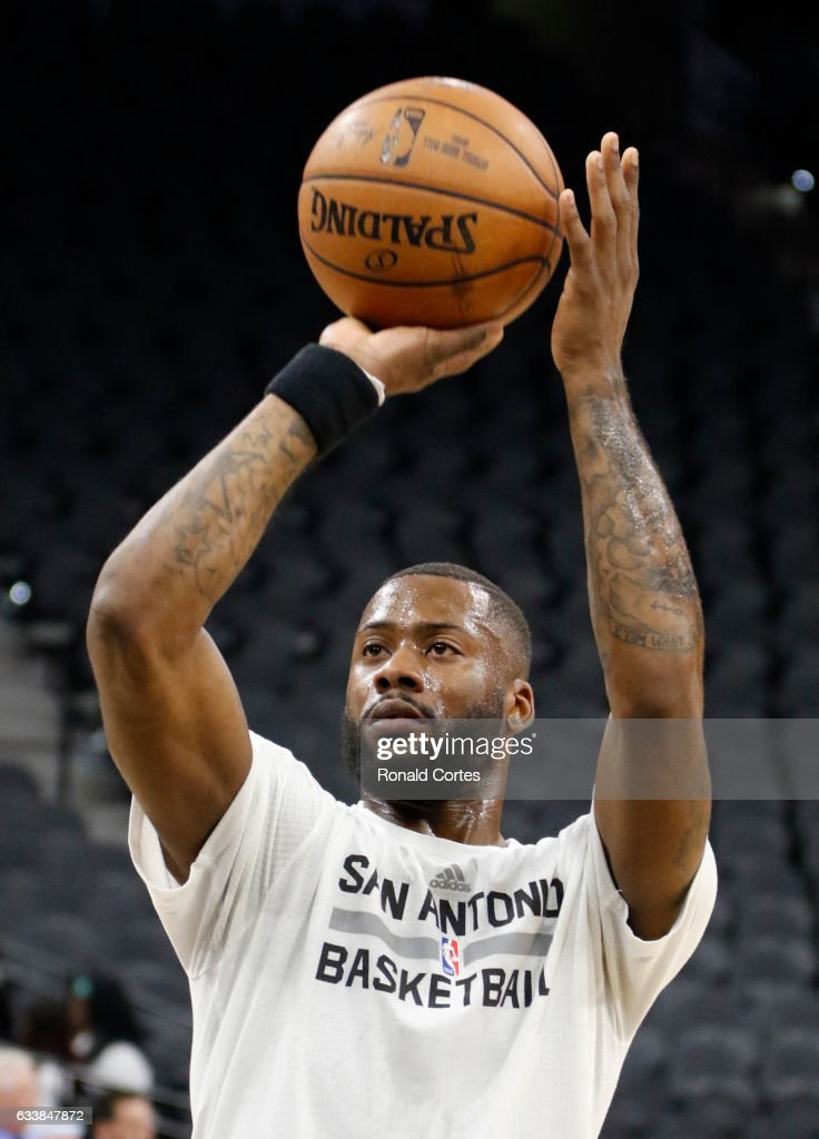 Jonathon Simmons #17 of the San Antonio Spurs takes practice shots before the start of their game against the Denver Nuggets at AT&T Center on November 5, 2016 in San Antonio, Texas.