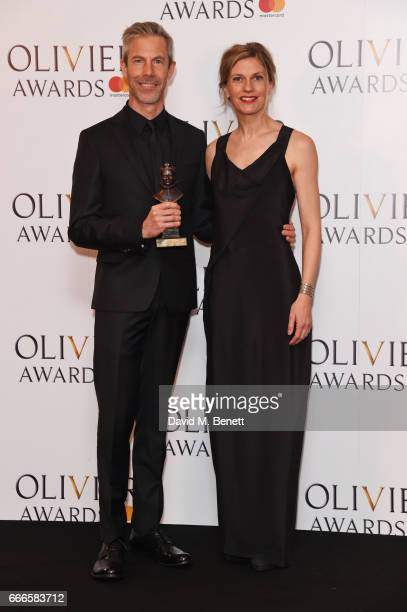 Jonathon Young and Crystal Pite pose in the winners room at The Olivier Awards 2017 at Royal Albert Hall on April 9 2017 in London England