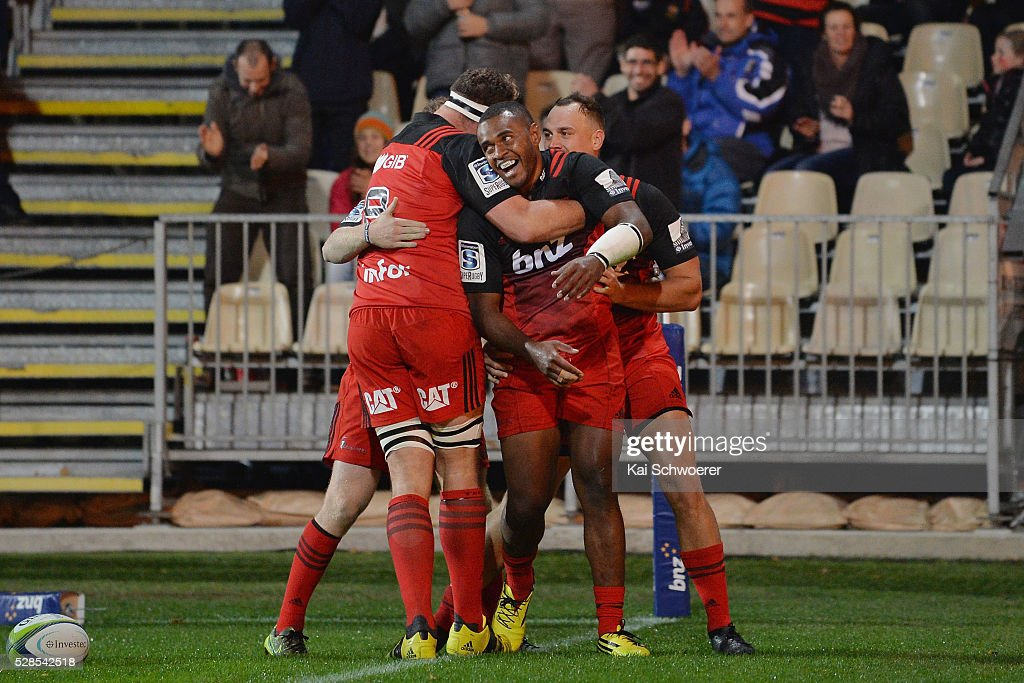 Jone Macilai of the Crusaders (C) and his teammates celebrate scoring a try during the round 11 Super Rugby match between the Crusaders and the Reds at AMI Stadium on May 6, 2016 in Christchurch, New Zealand.