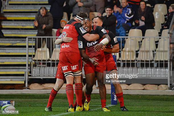 Jone Macilai of the Crusaders and his teammates celebrate scoring a try during the round 11 Super Rugby match between the Crusaders and the Reds at...