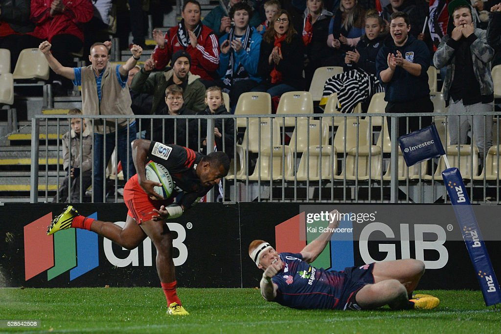 Jone Macilai of the Crusaders runs to score a try during the round 11 Super Rugby match between the Crusaders and the Reds at AMI Stadium on May 6, 2016 in Christchurch, New Zealand.