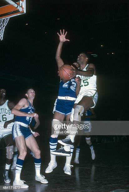 C Jones of the Boston Celtics goes to shoot over Elgin Baylor of the Los Angeles Lakers during an NBA basketball game circa 1965 at the Boston Garden...