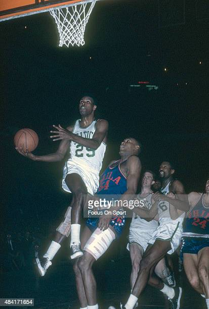 C Jones of the Boston Celtics goes up for a layup over Luke Jackson of the Philadelphia 76ers during an NBA basketball game circa 1965 at the Boston...
